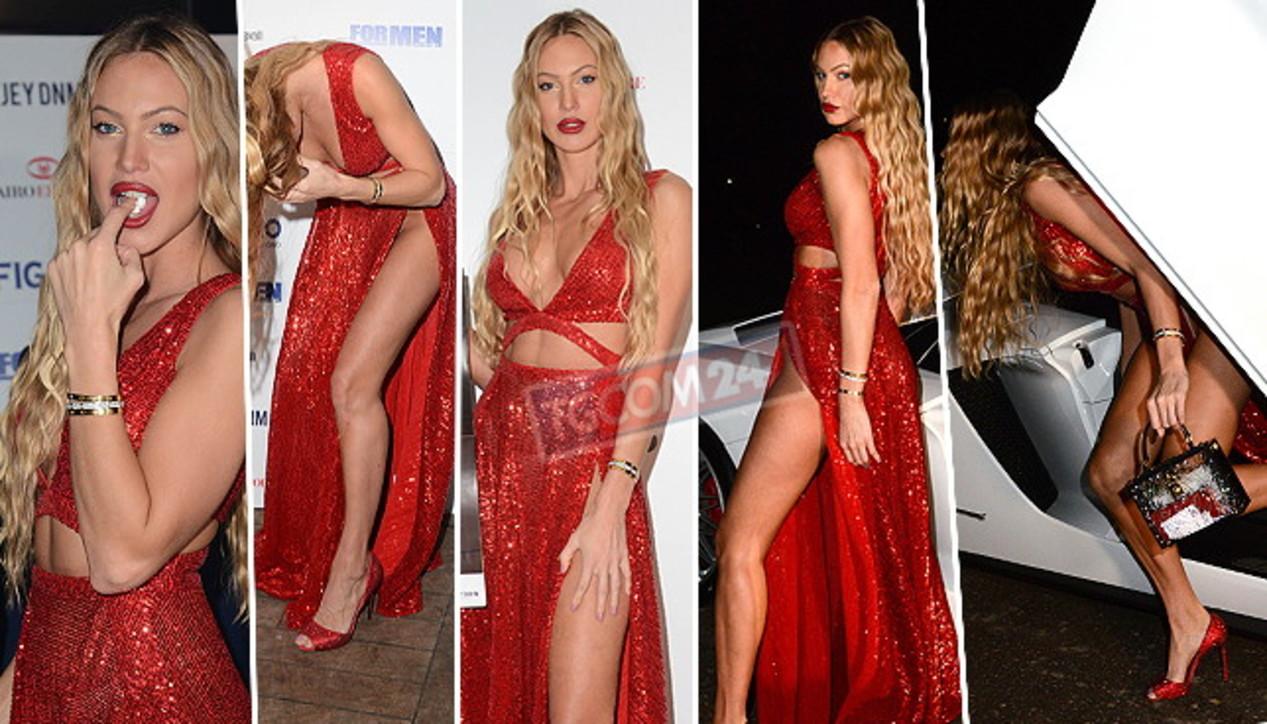 Taylor Mega sexy in rosso alla festa per il calendario senza veli