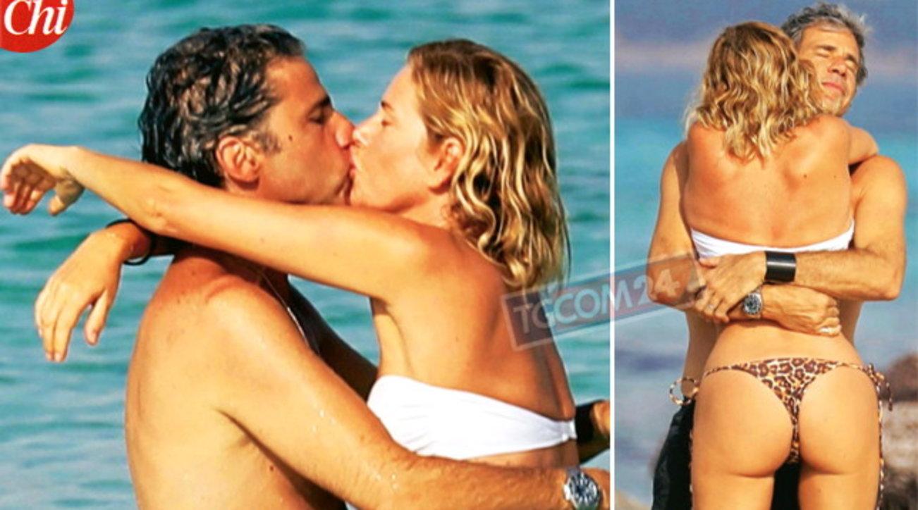 """Alessia Marcuzzi """"cozza"""" col marito al mare"""