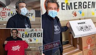 Flavio Insinna consegna i pacchi… di Emergency