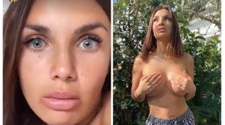 Elettra Lamborghini tiene in mano il seno nudo