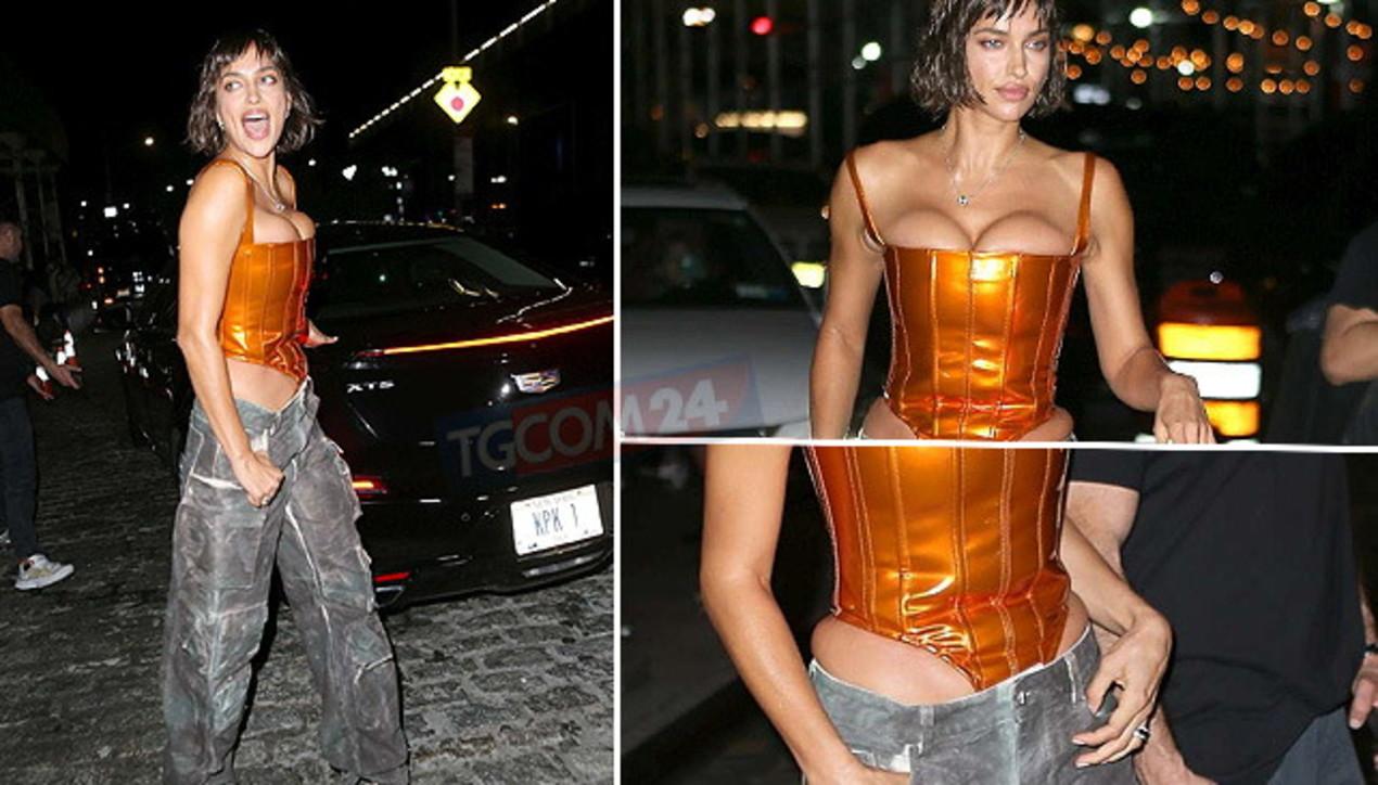 Irina Shayk col corsetto metallico alla festa americana fa faville